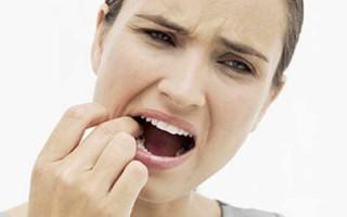 Болит зуб под коронкой: причины, особенности симптома, лечение